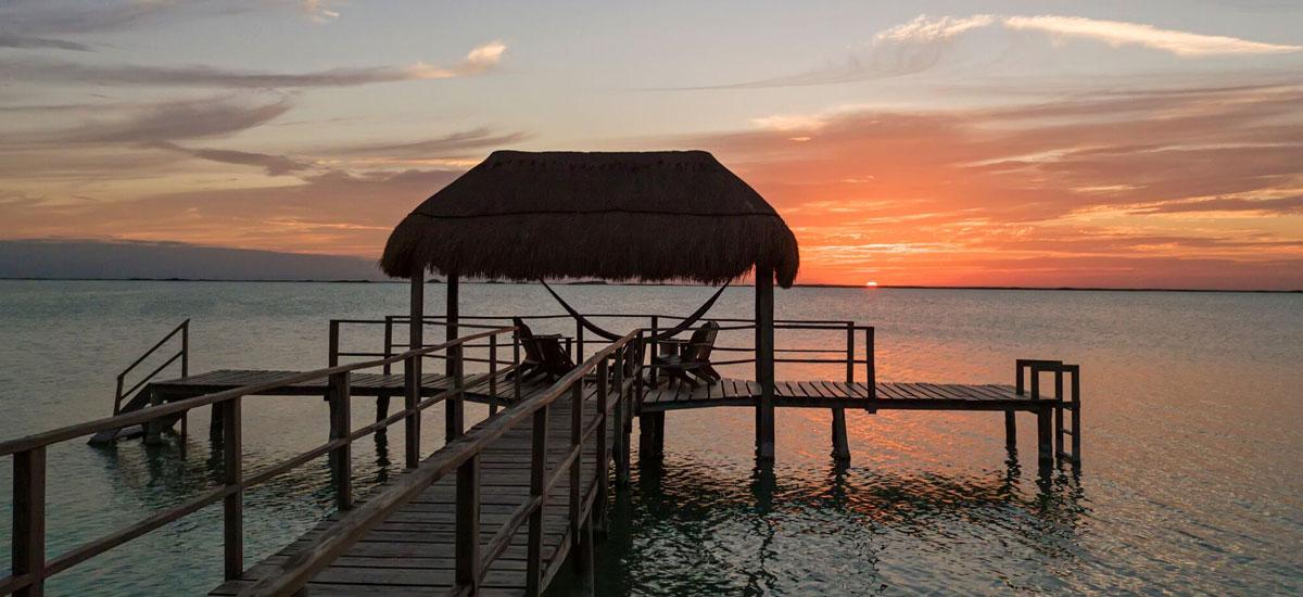 casa yakunah tulum pier sunset